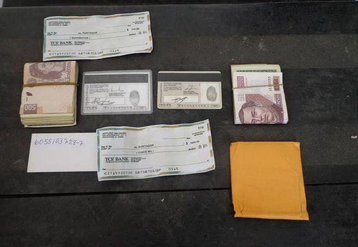 Los delincuentes mostraron a su víctima dos fajos de billetes que 'otra persona' les había cambiado. (SIPSE)