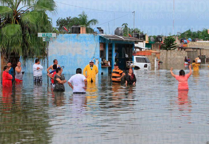el 53.57% de las colonias (112) tienen altas probabilidades de afectación por inundaciones en la capital. (Joel Zamora/SIPSE)