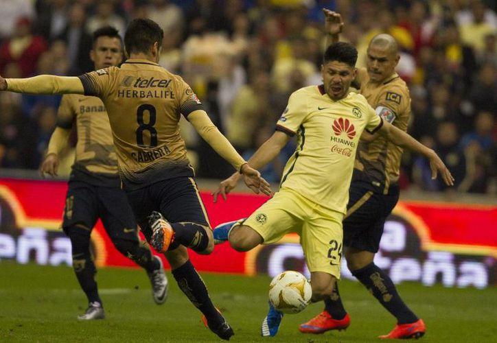 Pumas buscará concretar su pase a la final de la Liga MX este domingo, en el estadio de Ciudad Universitaria ante las Aguilas de América que esperan hacer el 'milagro' remontando el marcador adverso de 3-0. (Notimex)