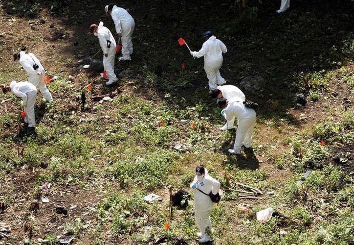 La OEA respaldó la labor del Grupo Interdisciplinario de Expertos Independientes sobre el peritaje en el basurero de Cocula. (Archivo/Agencias)