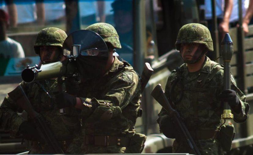 Personal militar arribó a la comunidad michoacana de Buenavista Tomatlán. (Archivo Notimex)