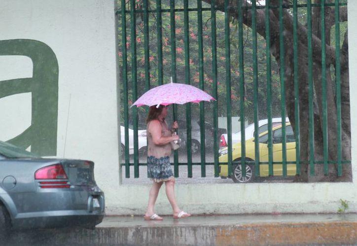 Las lluvias se hicieron presentes este jueves en la capital yucateca. (Jorge Acosta/ Milenio Novedades)