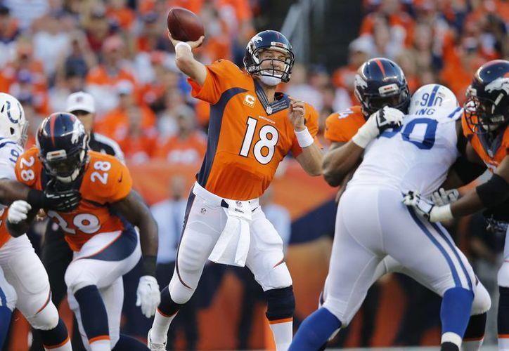 Manning terminó con 3 pases de anotación y 269 yardas. (Foto: AP)