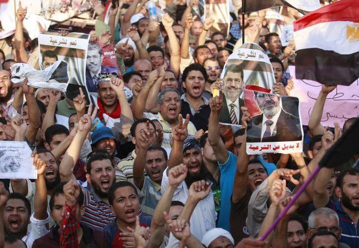 La designación del primer ministro está en negociones, según el presidente (interino) Adli Mansour. (Agencias)