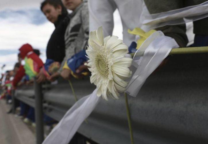 Los manifestantes llamaron a la unidad de México para enfrentar las políticas antimigrantes y antimexicanas del presidente Donald Trump. (AP/Christian Torres)