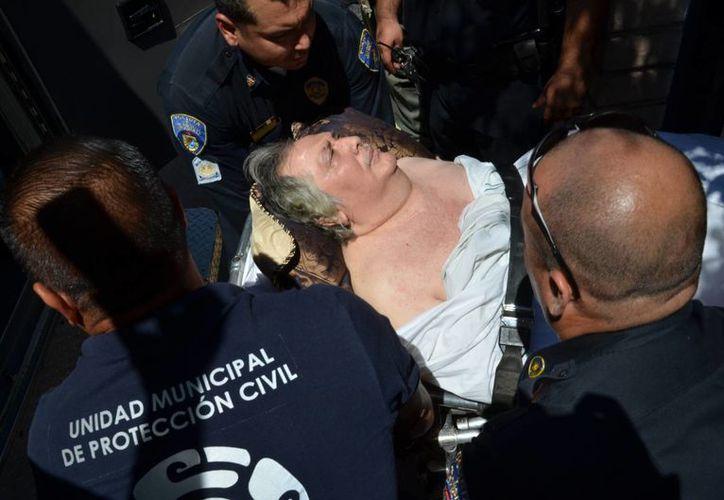 """El incendio en el asilo de ancianos """"Hermoso Atardecer"""" dejó un saldo de 16 adultos mayores fallecidos. (EFE)"""