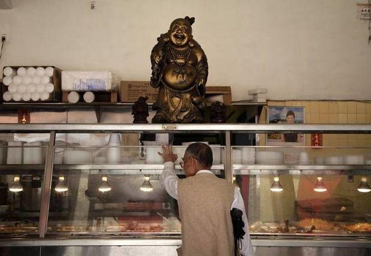 El esposo de Fang Zheng la obligaba a trabajar con él en un restaurante de comida china. (Agencias/foto de contexto)
