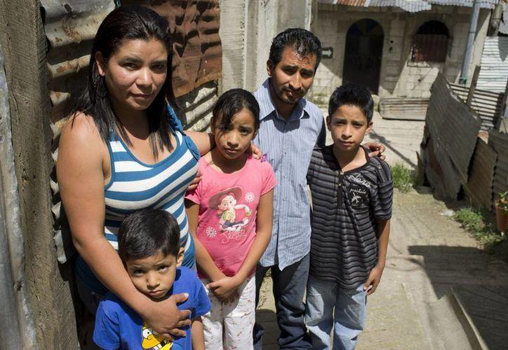 Gregoria Herminia Contreras junto a su familia. (Agencias)