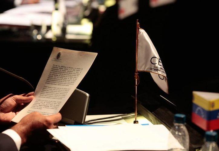 La carta de Chávez fue leída por el vicepresidente de Venezuela, Nicolás Maduro, durante la cumbre del Celac. (EFE)