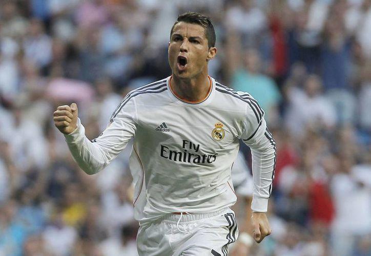 El presidente madridista resaltó la calidad del delantero portugués Cristiano Ronaldo, a quien calificó como el mejor jugador del mundo. (Agencias)
