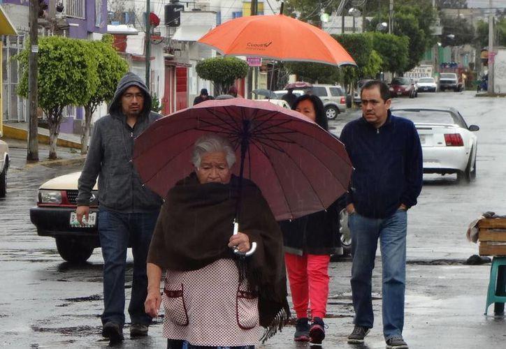 Según la Conagua, hoy lloverá con fuerza en Michoacán, Guerrero, Chiapas y Quintana Roo, y de forma más leve en el occidente, centro, sur y sureste de México. (Notimex)