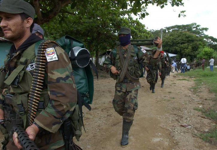 Actualmente las FARC tienen en un sus filas a unos 8 mil combatientes. (Archivo/EFE)