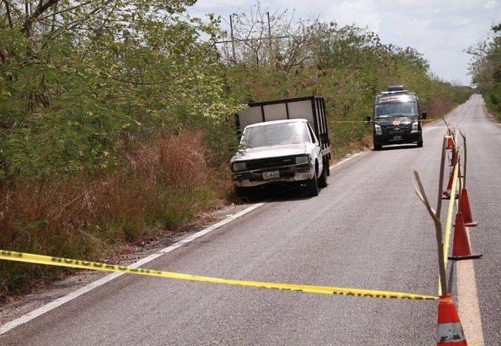 Imagen de uno de los vehículos involucrados en el millonario robo en la  carretera Calcehtok- Opichén. (Jorge Acosta/Milenio Novedades)