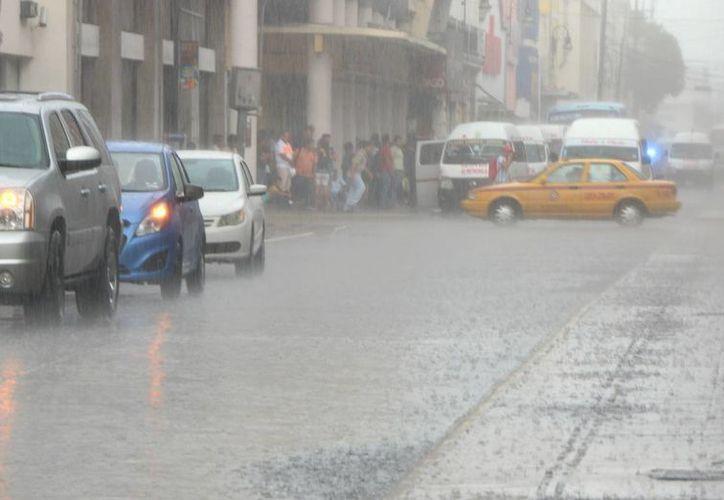 El Servicio Meteorológico Nacional recomienda a la población tomar precauciones por las intensas lluvias que se espera para este fin de semana. (José Acosta/Milenio Novedades)