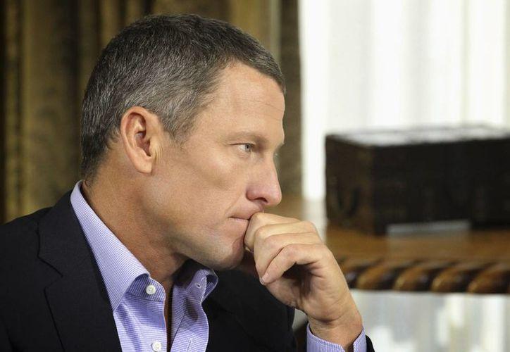 Armstrong fue despojado de sus siete títulos del Tour de Francia porque se dopó. (Agencias)