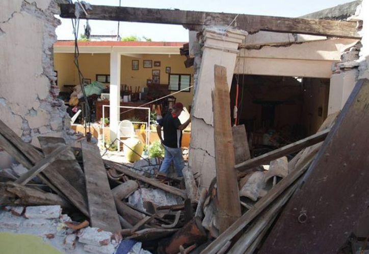 La afectada por el sismo del 7 de septiembre, perdió su casa totalmente. (Foto: Excélsior).
