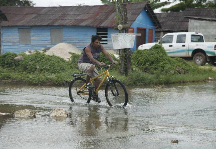 En las localidades del municipio de Bacalar, como Huatusco y Río Escondido, empezó a descender el nivel de agua. (Redacción/SIPSE)