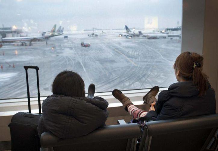 Los dos aeropuertos de Nueva York: La Guardia y John F. Kennedy, suspendieron 206 y 92 vuelos respectivamente. (Foto de Archivo/Notimex)