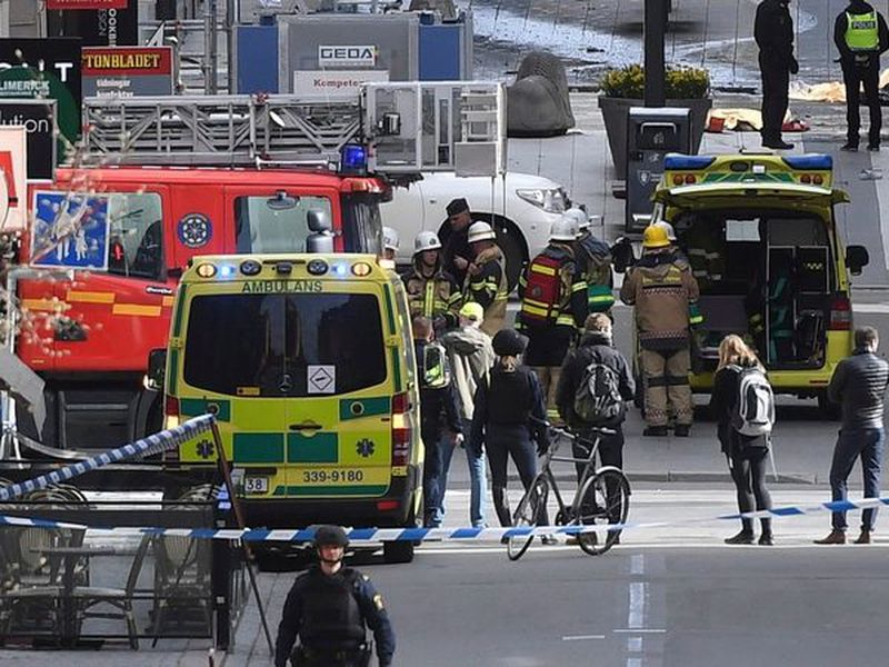 This is a April 7, 2017 file photo, showing emergency services at the scene of an attack on Drottninggatan street in central Stockholm.