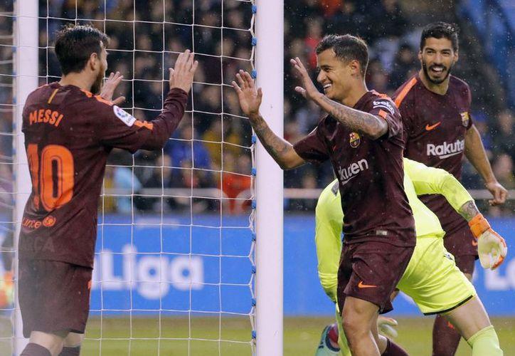 FC Barcelona ganó este día con un triplete de Lionel Messi, una semana después de haber ganado la Copa del Rey para sellar el doblete. (Vanguardia MX)
