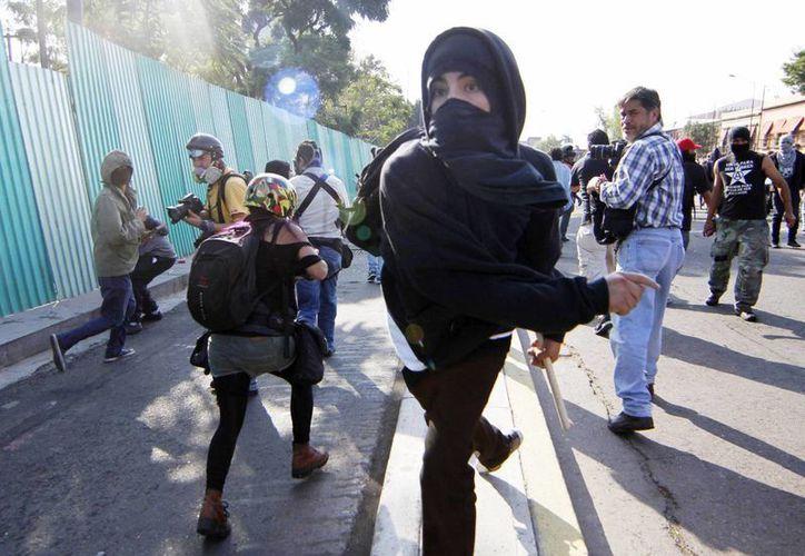 Los anarquistas son señalados como los generadores de violencia en las recientes manifestaciones en el D.F. (Notimex)