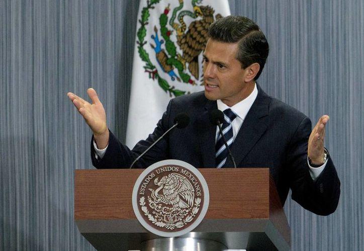 Peña Nieto indicó que la reforma hacendaria impulsa la formalización de los emprendedores mexicanos gracias a un nuevo régimen fiscal. (Notimex)