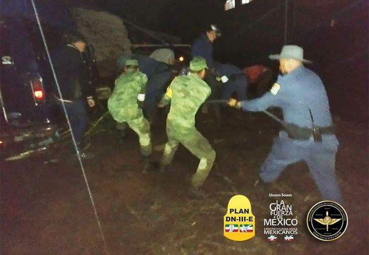 Los militares apoyan por los daños ocasionados por las fuertes lluvias.(@SEDENAmx)