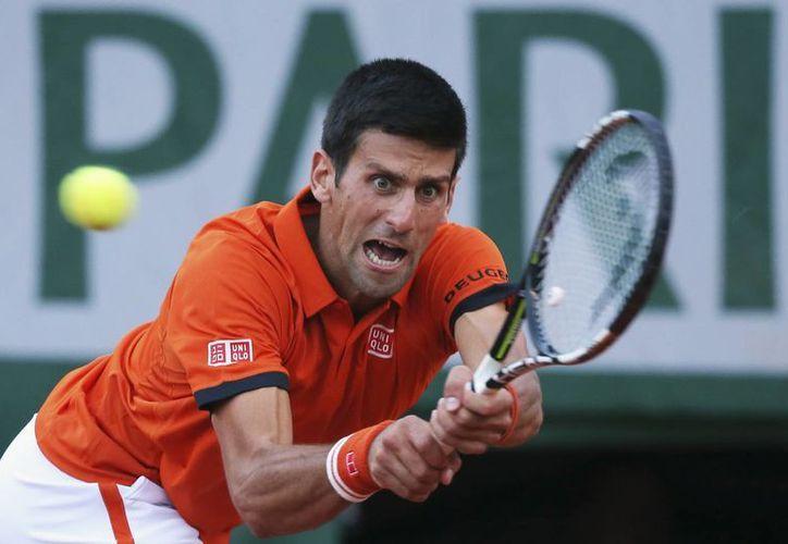 Djokovic ganaba a Murray en la segunda semifinal del Abierto de Francia, pero el juego se tuvo que suspender por lluvia. (Fotos: AP)