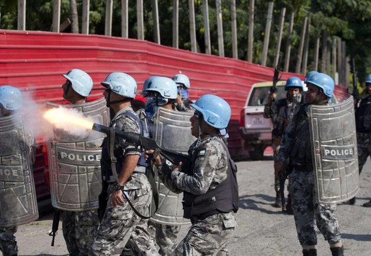 La capital haitiana, Puerto Príncipe, vivió un viernes de intensas protestas. (AP)