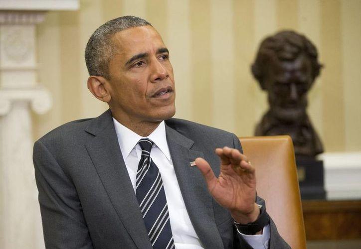 Obama anunció en noviembre de 2014 un paquete de medidas para beneficiar a millones de indocumentados, pero hasta el momento han sido ejecutadas. (AP)