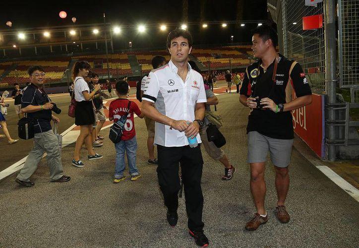 Previo al Gran Premio de Singapur, el piloto mexicano mostró su preocupación por la catástrofe desencadenada por los ciclones tropicales 'Manuel' e 'Ingrid'. (Agencias)