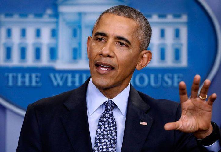 Barack Obama en imagen del 18 de junio de 2017, cerca de entregar la Presidencia a Donald Trump. El expresidente respondió a Trump sobre las acusaciones de que intervino sus conversaciones. (AP/Pablo Martinez Monsiváis)