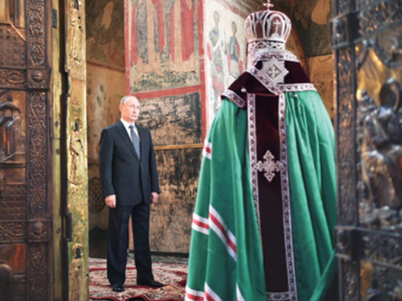 Russian President Vladimir Putin attends a service held by Russian Orthodox Patriarch Krill, right, in the Annunciation Cathedral after the inauguration ceremony in the Kremlin in Moscow, Russia. (AP)
