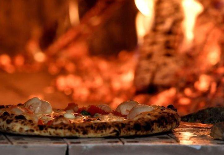 Pizza University ofrece varias clases de pizza tradicional, pero también tienen cursos en otras artes culinarias. (AFP)