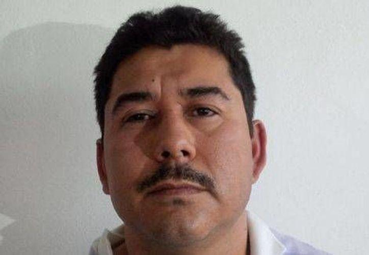 Carlos Hoo Ramírez fue detenido en posesión de armas largas y cientos de cartuchos al ser detenido. (Archivo/Agencias)