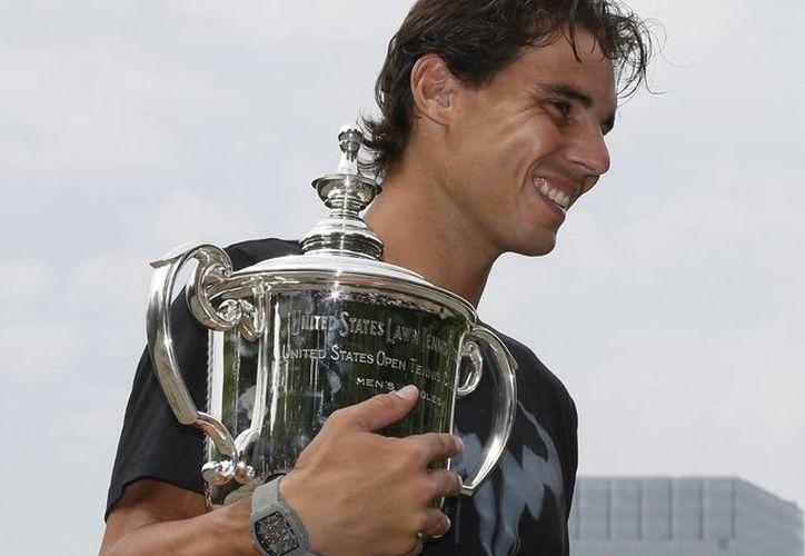 El tenisma mallorquín conquistó el lunes su 13er título de Grand Slam con una victoria sobre Novak Djokovic en el US Open. (Agencias)