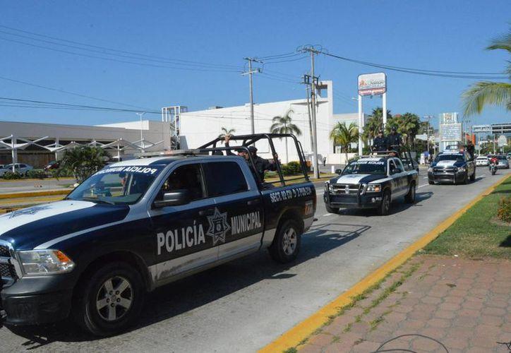 Autoridades federales, estatales y municipales desplegaron un operativo de seguridad para dar con los asesinos de Andrés Lara García y Raúl Parra Herrera. (Archivo/Notimex)