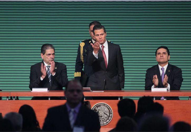 Al cierre de la Asamblea General del Consejo Nacional Agropecuario, Peña Nieto aseguró que el 2014 ha sido un año de claroscuros para México. (Notimex)