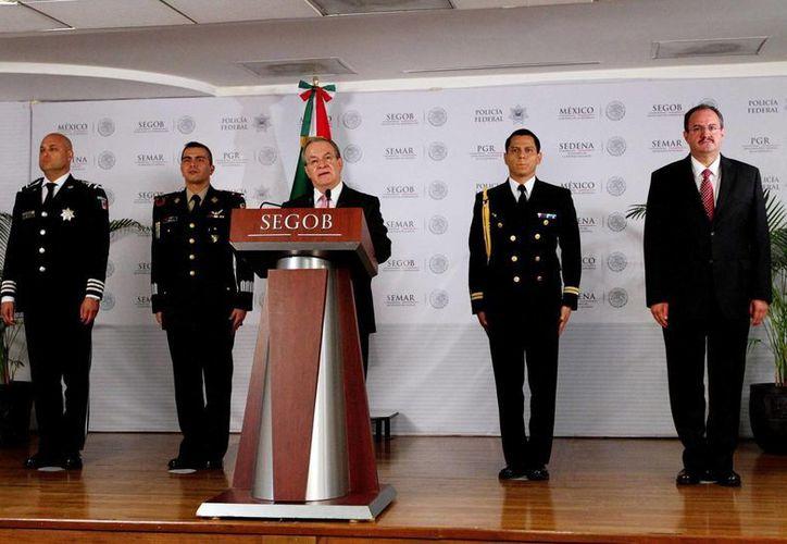 El comisionado de Seguridad, Monte Alejandro Rubido, indicó que las detenciones se realizaron sin necesidad de disparos. (Notimex)