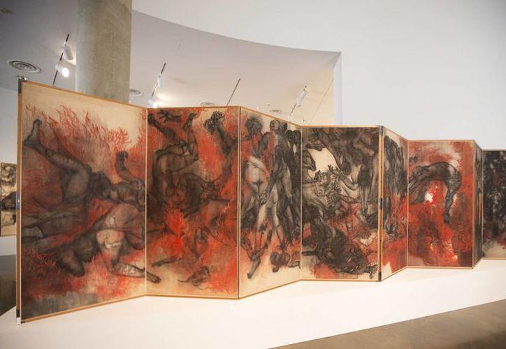 Desplegado de arte hecho en 1950, alusivo a la caída de las bombas atómicas en las ciudades japonesas de Hiroshima y Nagasaki durante el final de la Segunda Guerra Mundial en 1945. La foto del desplegado fue tomada este 10 de junio. (Foto: AP)