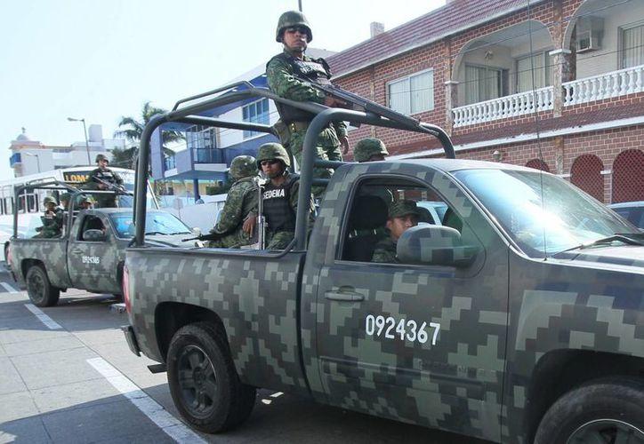 El año pasado se mantuvieron disponibles 16 mil 92 efectivos del Ejército en funciones de soporte de seguridad a los cuerpos policiales. (Archivo/Notimex)