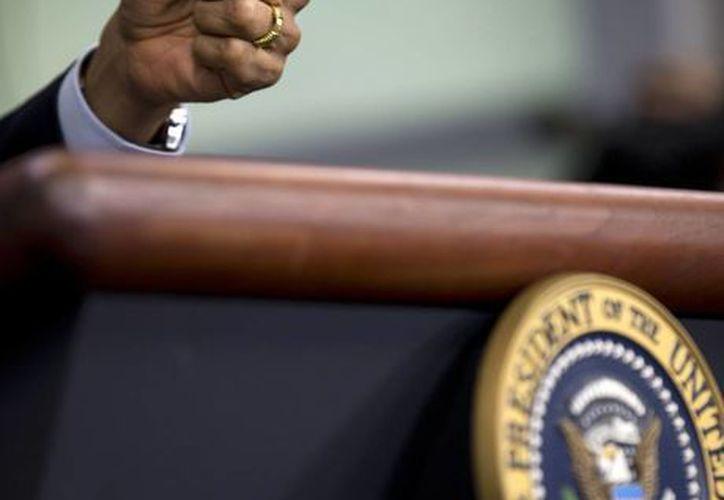 La mano del presidente Barack Obama durante la conferencia de prensa en la Casa Blanca. (AP)