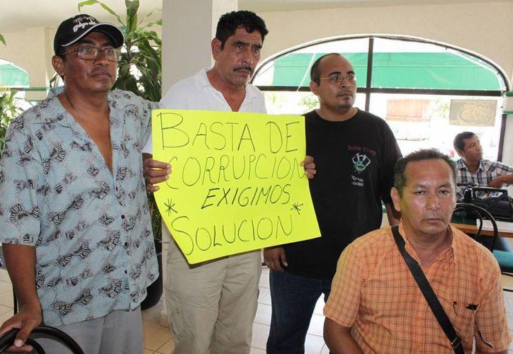 Los afectados en el asunto exigen solución. (Adrián Barreto/SIPSE)