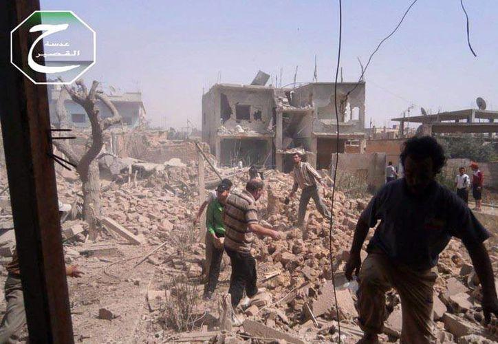 Fuerzas del Gobierno rodearon Qusair, una ciudad de 20 mil habitantes, clave para mermar algo del poder de los rebeldes. (Agencias)