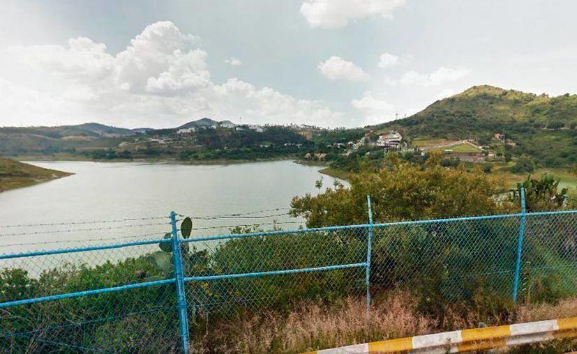 Imagen de la presa Madin, ubicada en los límites de la Ciudad de México. El Gobierno destina millones de pesos, cada año, para el desazolve y limpieza de estos depósitos de agua. (Street View/Google Maps)