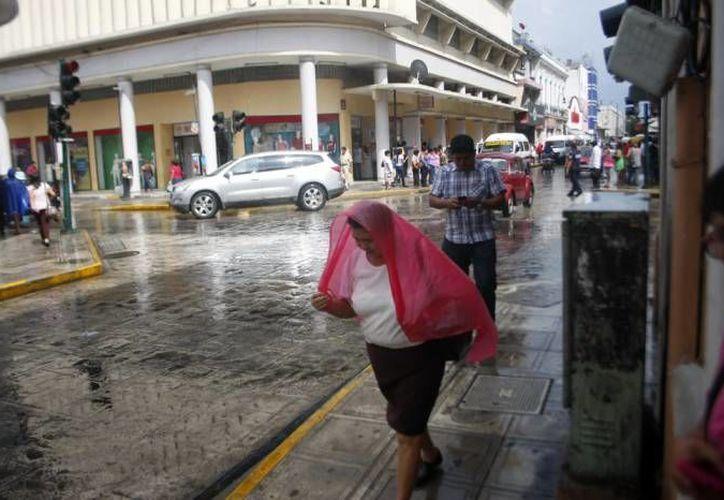 La Conagua pronostica que una vaguada se extenderá sobre la Península de Yucatán, lo que generaría fuertes chubascos al oriente y centro. (SIPSE)