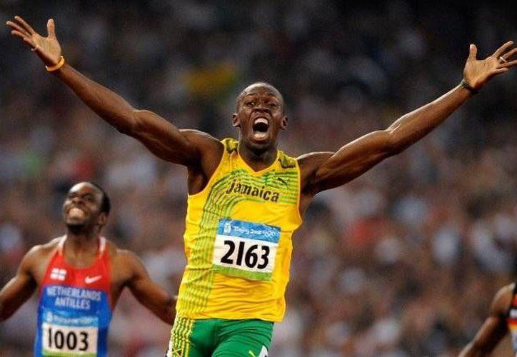 Usain Bolt aún no tiene claro los planes sobre su futuro, pues afirmó que podría posponer su retiro de las competencias el cual estaba señalado para 2017. (Archivo AP)