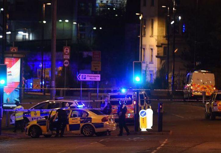 El concierto que Ariana Grande daba en la Arena Manchester terminó con explosiones, que las autoridades locales atribuyen a terroristas. (AFP)