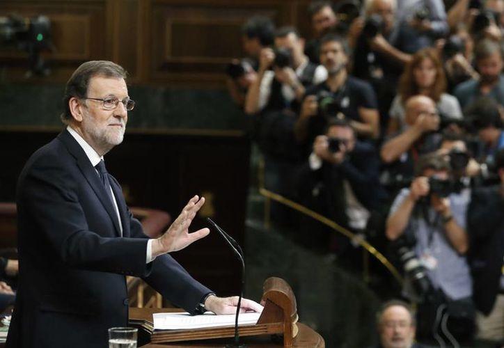 El líder del PP y presidente del Gobierno en funciones, Mariano Rajoy, durante su intervención en el debate de su investidura, esta tarde en la Cámara Baja. (EFE)