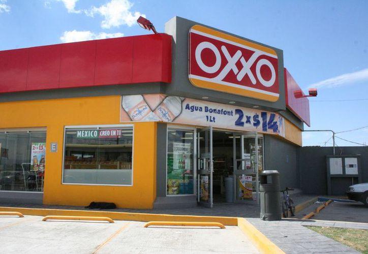 Firmaron el convenio de colaboración entre el Gobierno de Quintana Roo y Tiendas de Conveniencia Oxxo. (Foto: Contexto/Internet)